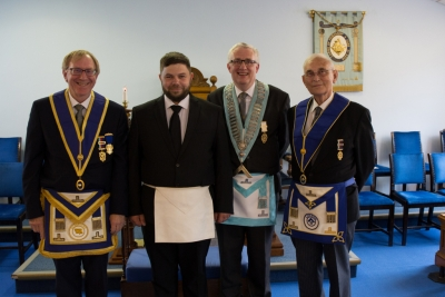 Newly initiated Bro. Maurice Buddin twith the Master and Wardens