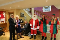 Santa accompanied by his Elves and Cllr Bob Pitts Mayor of Wokingham Borough with his wife Val
